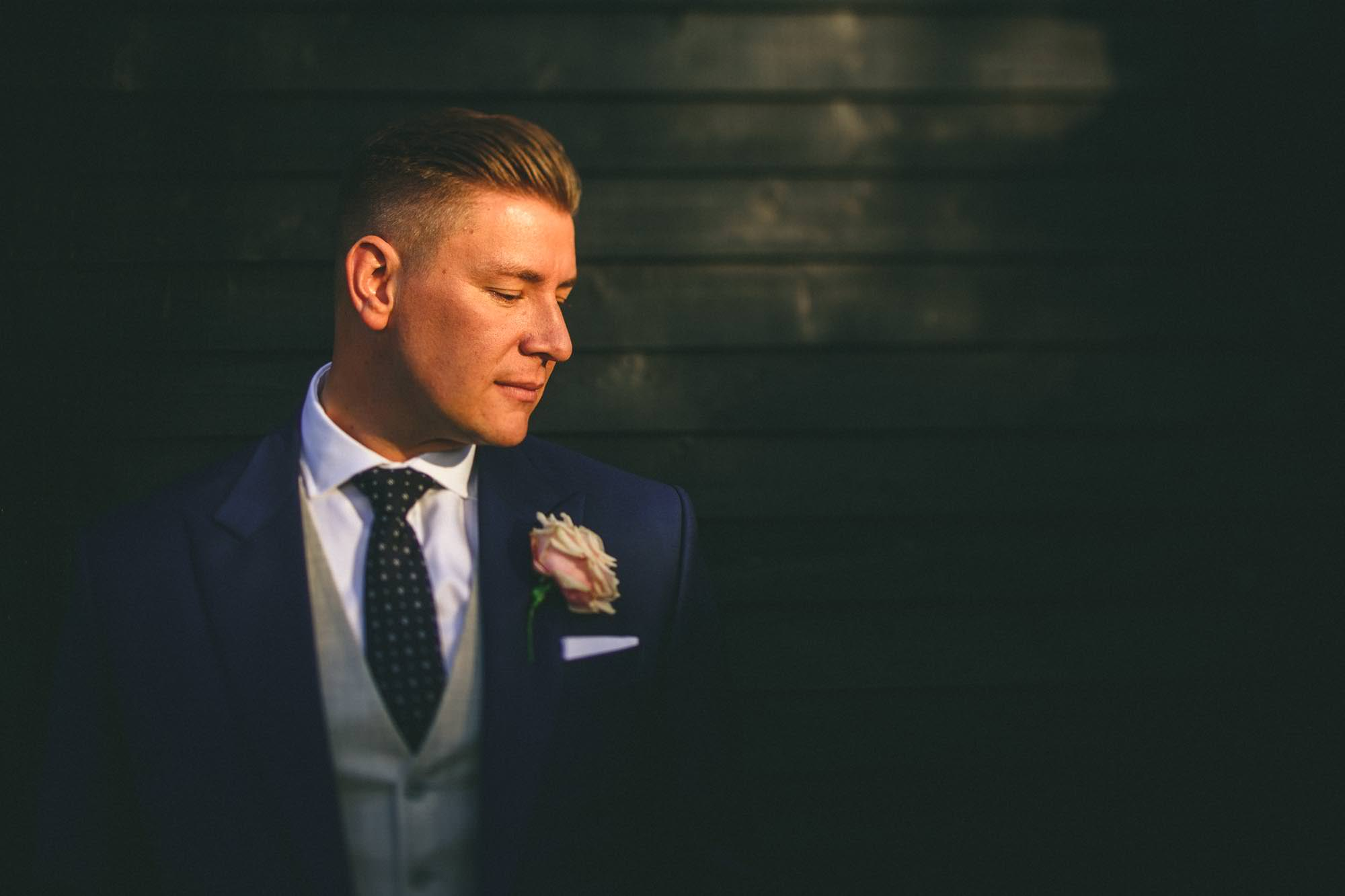 A suit that fits groom Miki Photography Kent