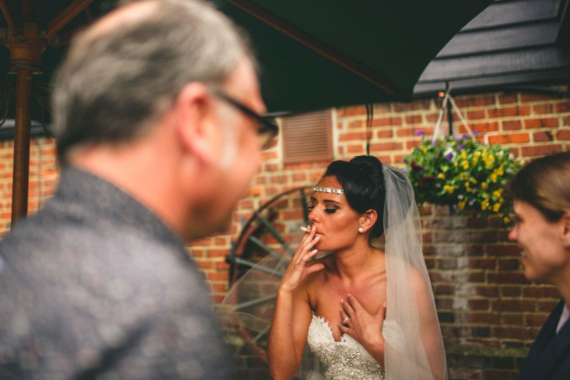 Bride Smoking on Wedding Day Miki Photography